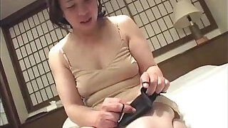 Asian granny inserts a vibrator in her pussy - 7:00