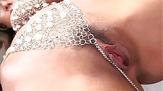 MILF in rhinestones fingers and toys her trimmed pussy - 7:00